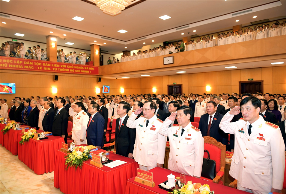 The delegates observe the flag-raising ceremony at the 7th Public Security Party Congress.