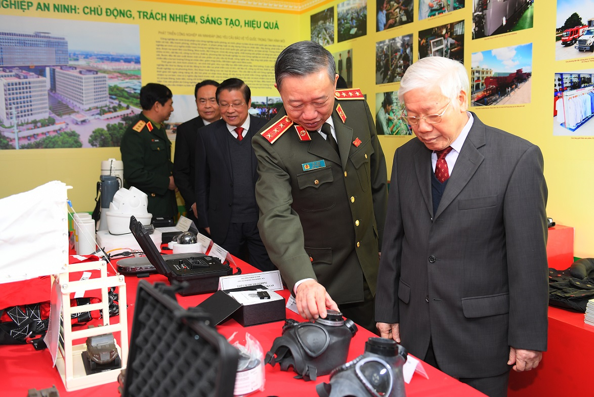 General Secretary and State President Nguyen Phu Trong, Minister To Lam and other delegates visit the exhibition area on the sidelines of the Conference.