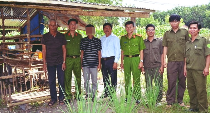 Members of the Management Board of Tan Chau Community Reintegration Development Fund visit a former convict who was lent capital to raise goats.