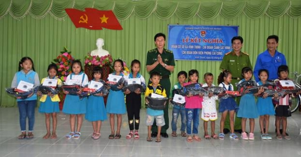 Representatives of the 3 Youth Union Chapters present gifts to local students.