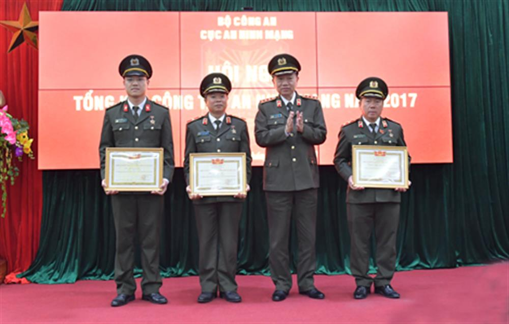 Minister To Lam honoring outstanding individuals of the unit.