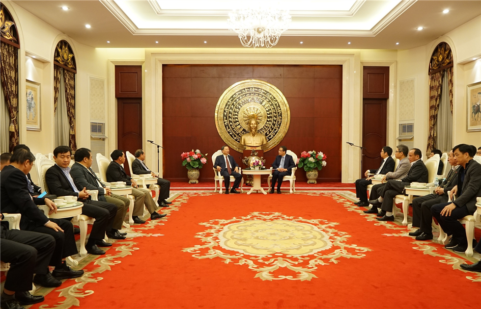 Minister To Lam and his delegation visit the Embassy of Vietnam in China.