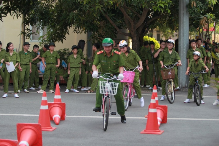 They practice riding bikes safely in difficult traffic situations.